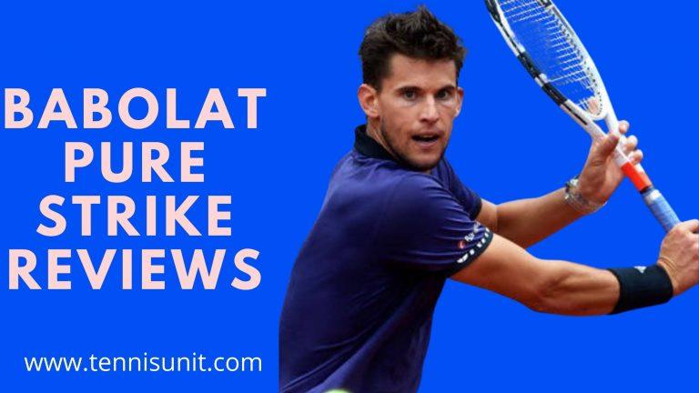 men holding Babolat pure strike tennis racket